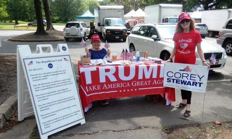 Mason Farmers Market in Annandale with Lola LeCraw, supported by an Adorable Deplorable (Mary Tanzer), wave the flags for U.S. Senate candidate Corey Stewart, the Republican Creed, and President Trump