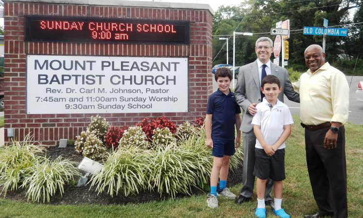 Gary Aiken, Mason District Supervisor candidate, introduced his sons, Emmett, 11, and Tyler, 9, to Rev. Dr. Carl M. Johnson, Pastor of Mount Pleasant Baptist Church in Alexandria. Rev. Johnson talked about issues that concerned his community